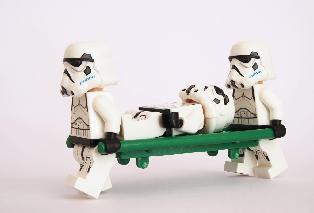 Storm Troopers carrying the wounded to safety.