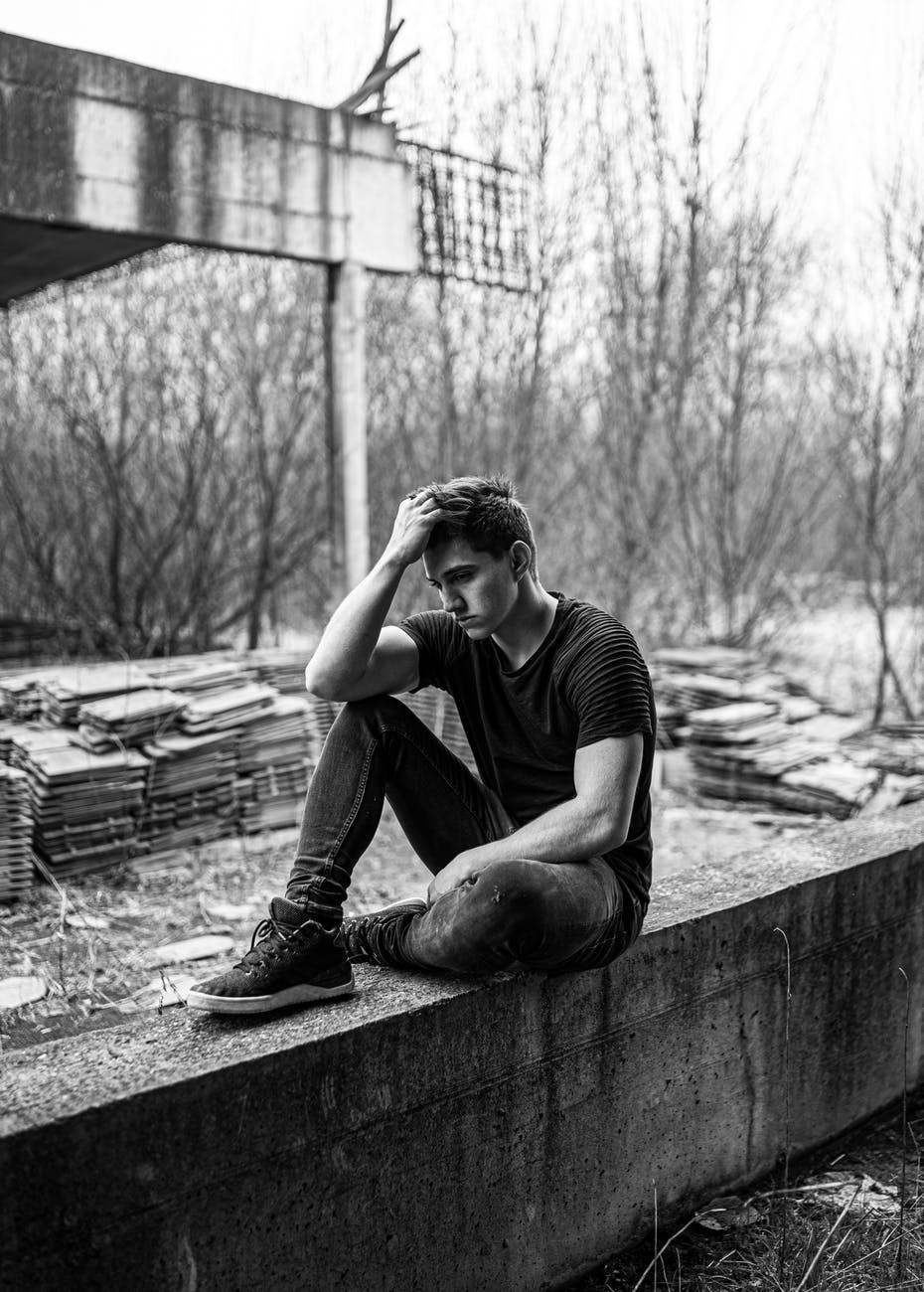 man sitting on concrete bench - He may not talk about it, but he also feels lost, down, and internally broken. Read about a writer who has decided to speak up about his struggles with mental illness. | #MentalIllness #bipolar #mentalillnessawareness