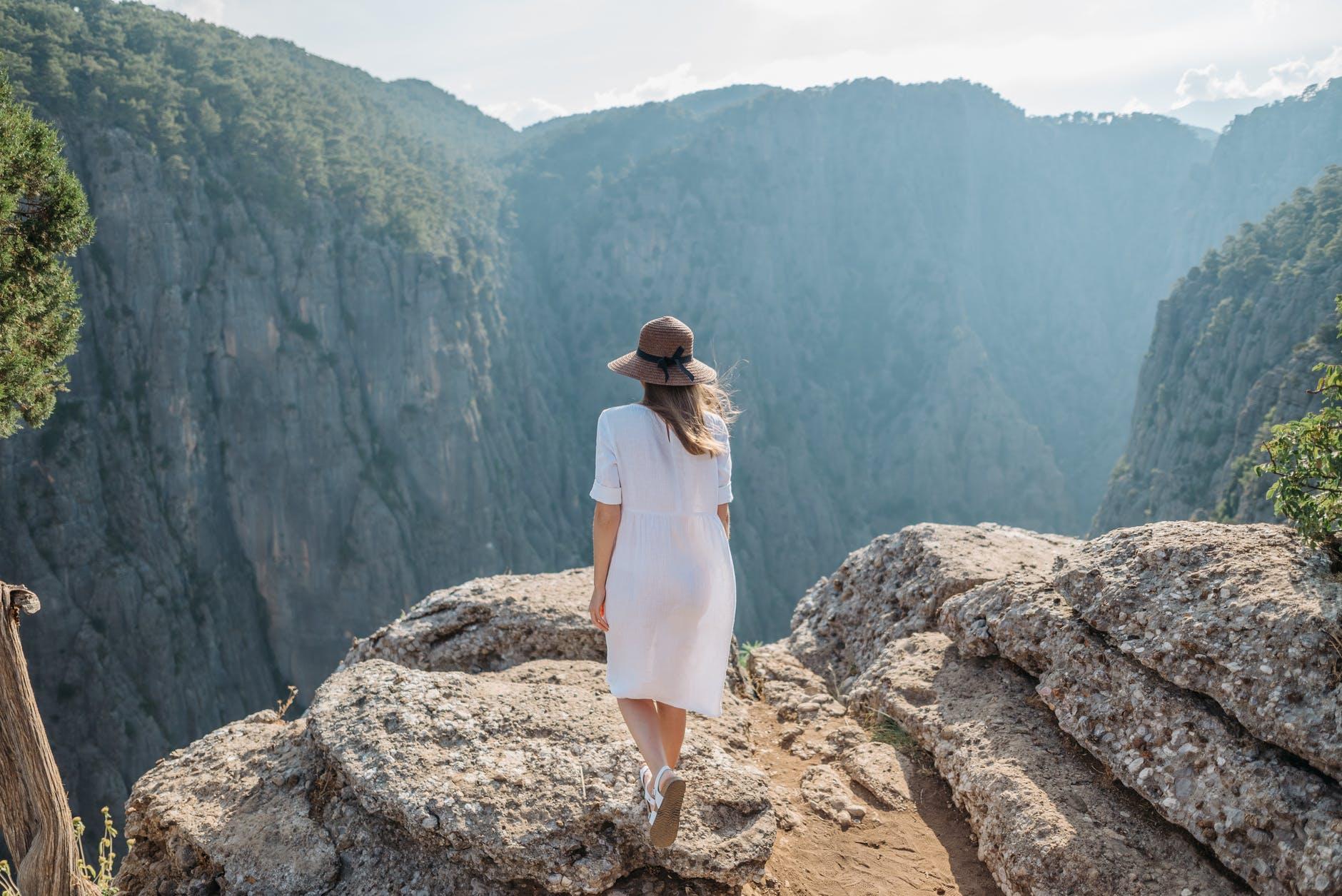 woman walking near a cliff